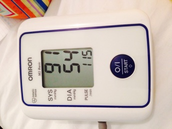Blood pressure monitor showing blood pressure of 91/54 mmHg, which is a bit low (normal is 120/80 mmHg) and a heart rate of 115 beats/min, which is tooooo fast (normal 60-100 bpm)