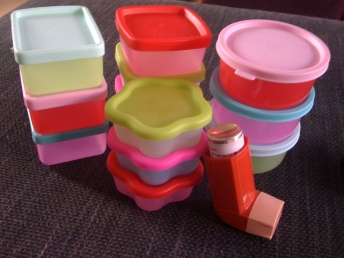 Towers of small, brightly-coloured plastic pots with lids - small enough to fit a baby portion of food, which is perfect for gastroparesis